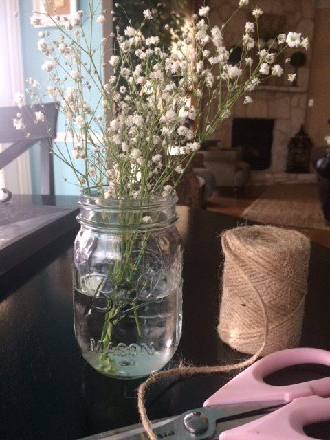 Left over baby's Breath, jar, twine and scissors
