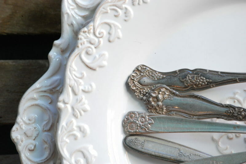 White dishes with antique spoon handles