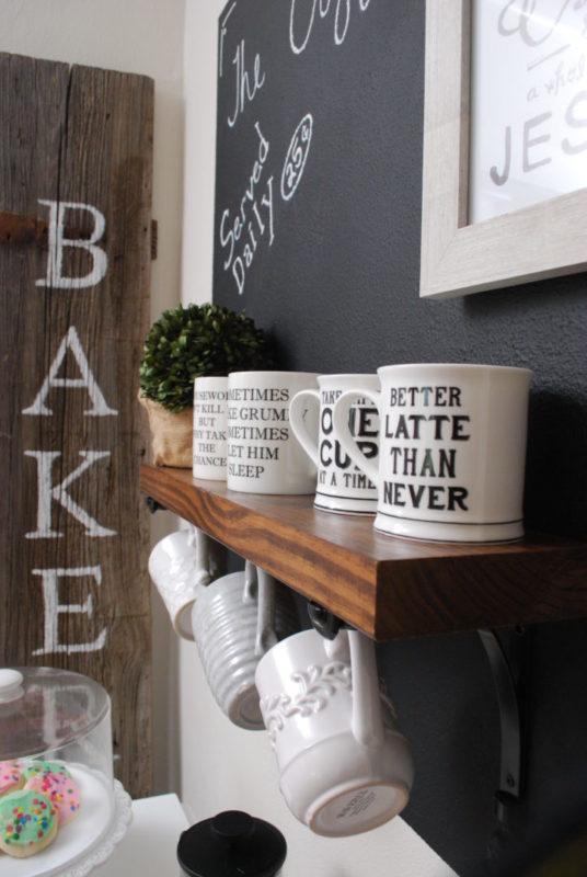 Coffee mug shelf with brackets and hooks