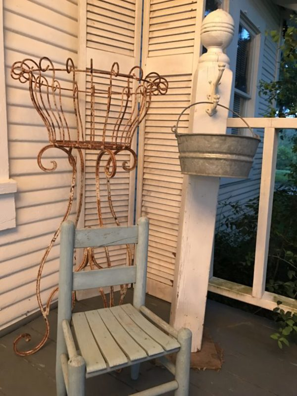 Old column on porch with bucket
