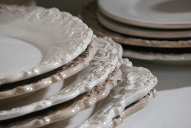 Stacked white dishes with scrolled detail