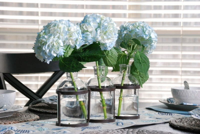 Metal floral vase with 3 glass jars makes a simple centerpiece perfect for flowers