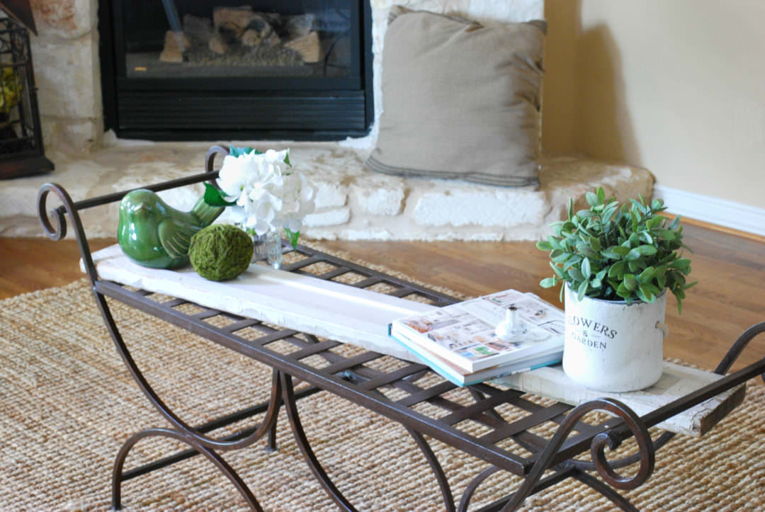 garden bench used as a coffee table refresh with chippy painted board and accessories