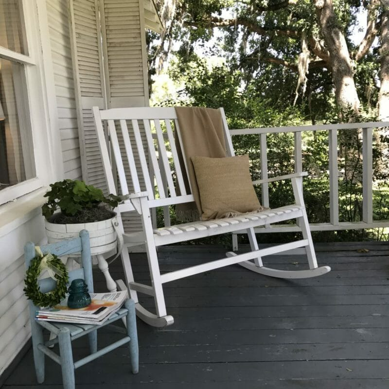 country front porch with spring decor