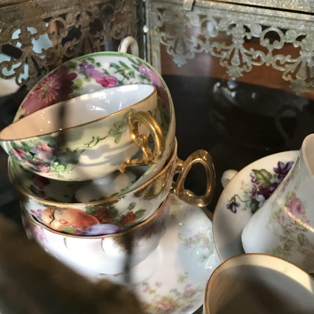 Stacked antique cups and saucers