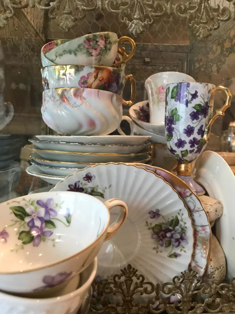 Vintage Teacup collection displayed in glass birdcage