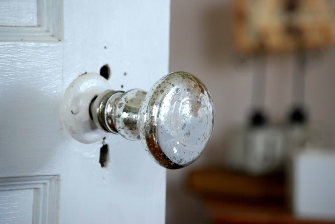 Mercury glass door knob in the farmhouse bedroom