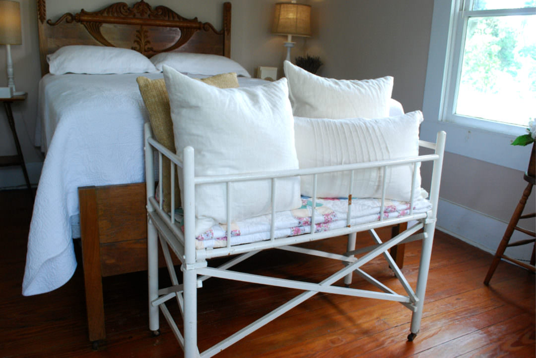 vintage baby cradle makes an great addition to the farmhouse bedroom