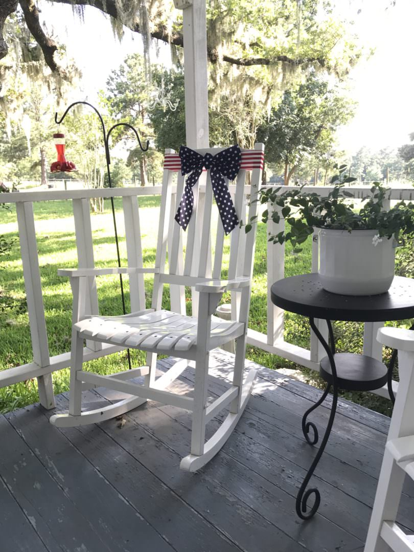 patriotic ribbon fits perfectly on the rocking chair of the farmhouse front porch