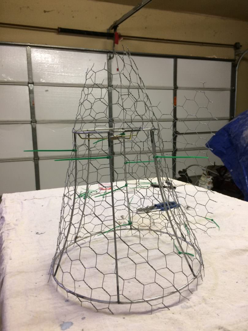 The chicken wire is wrapped around the lamp shade ready for trimming