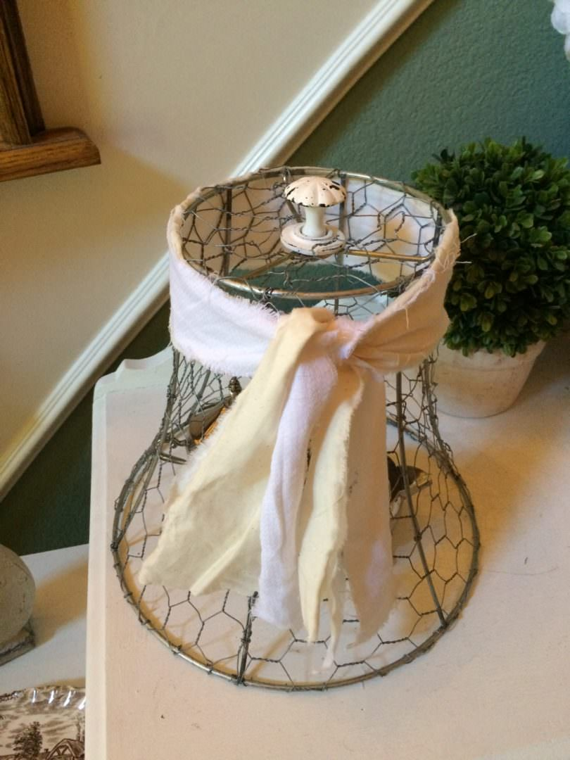 Strips of fabric used to make this chicken wire cloce have a shabby chic look