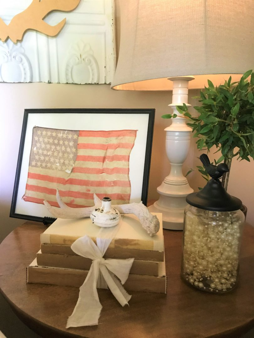 July 4th decor with vintage flag and books