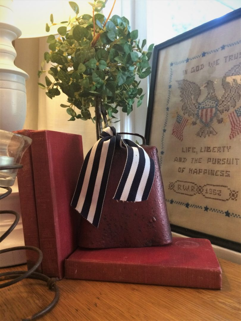 vintage books and cow bell with hand stitched cloth in frame for July 4th farmhouse decordecor