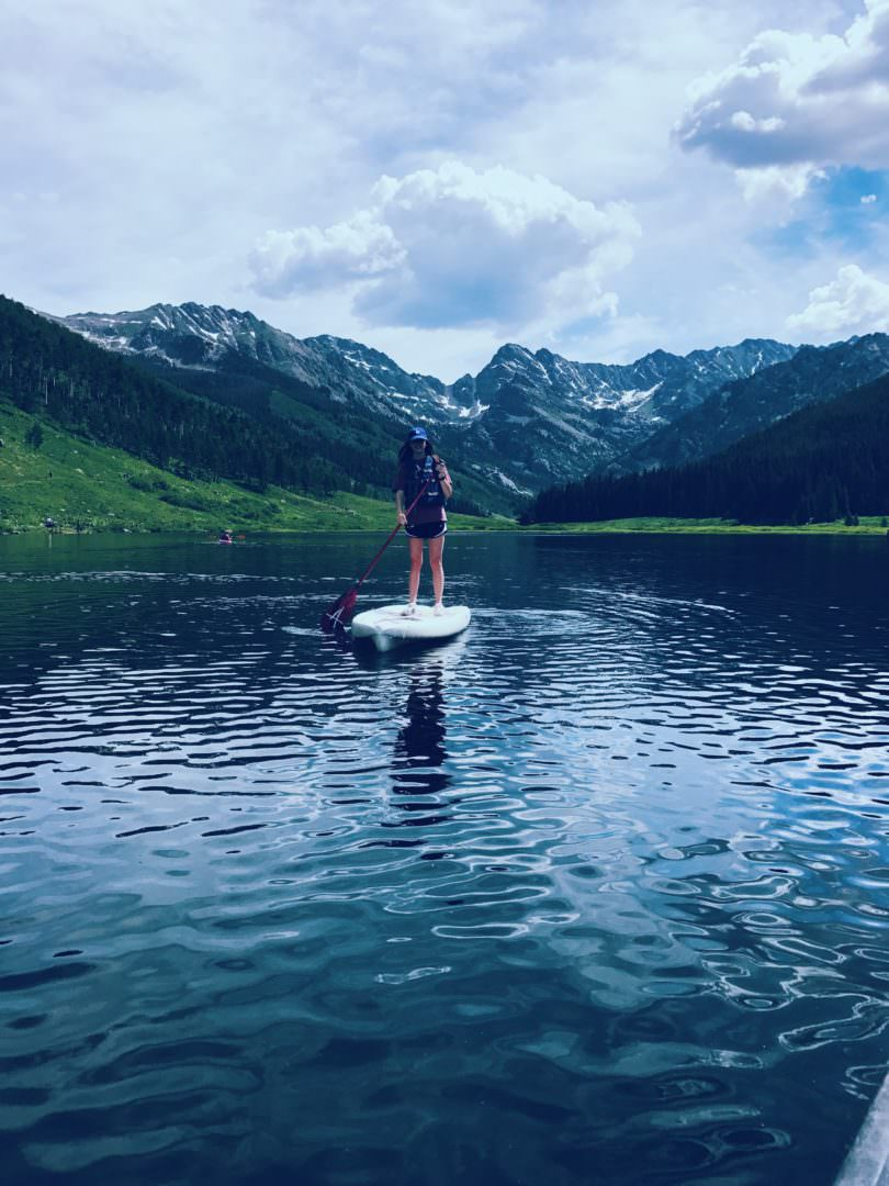 Paddle boarding on Piney Woods Lake in Colorado