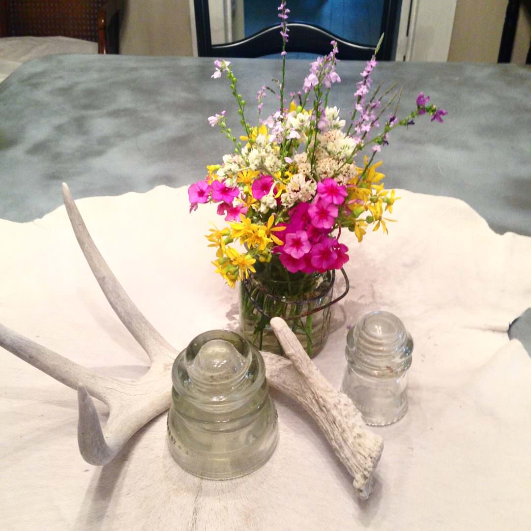 Centerpiece with vintage transformers, antlers, and wild flowers