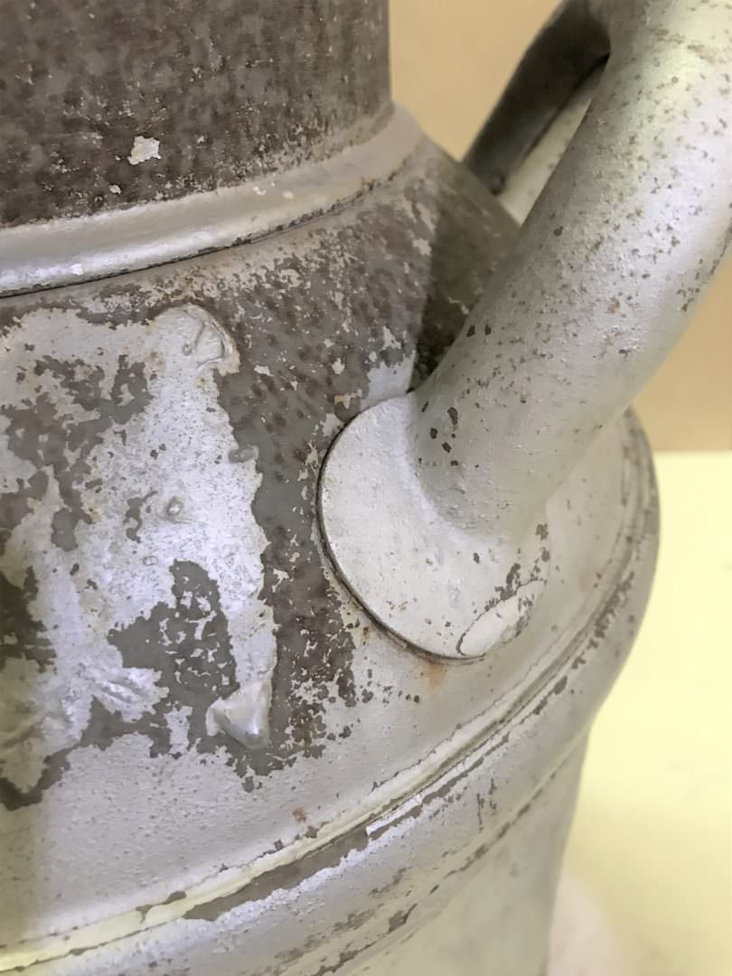 vintage milk can handle with rust before painting