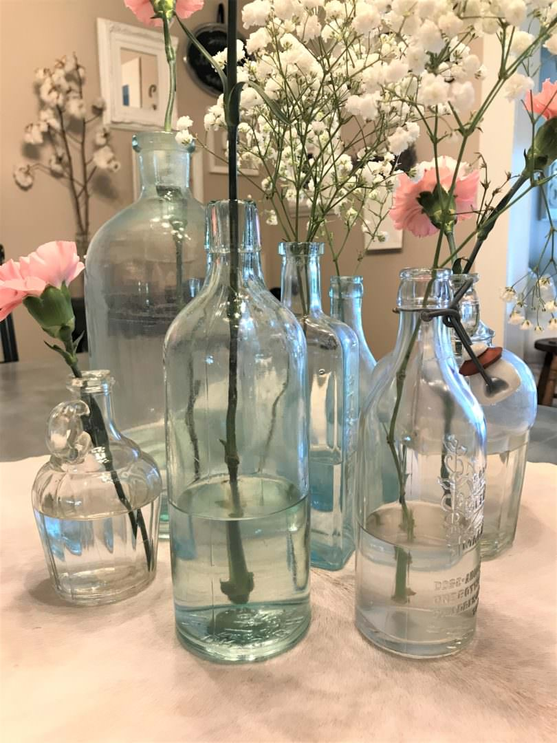 vintage bottles with flowers