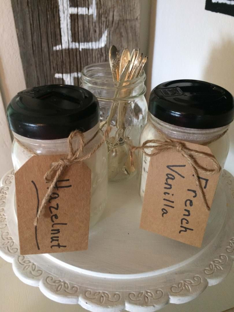 Ball jars with Coffee-Mate creamer lids painted black for a better farmhouse style look
