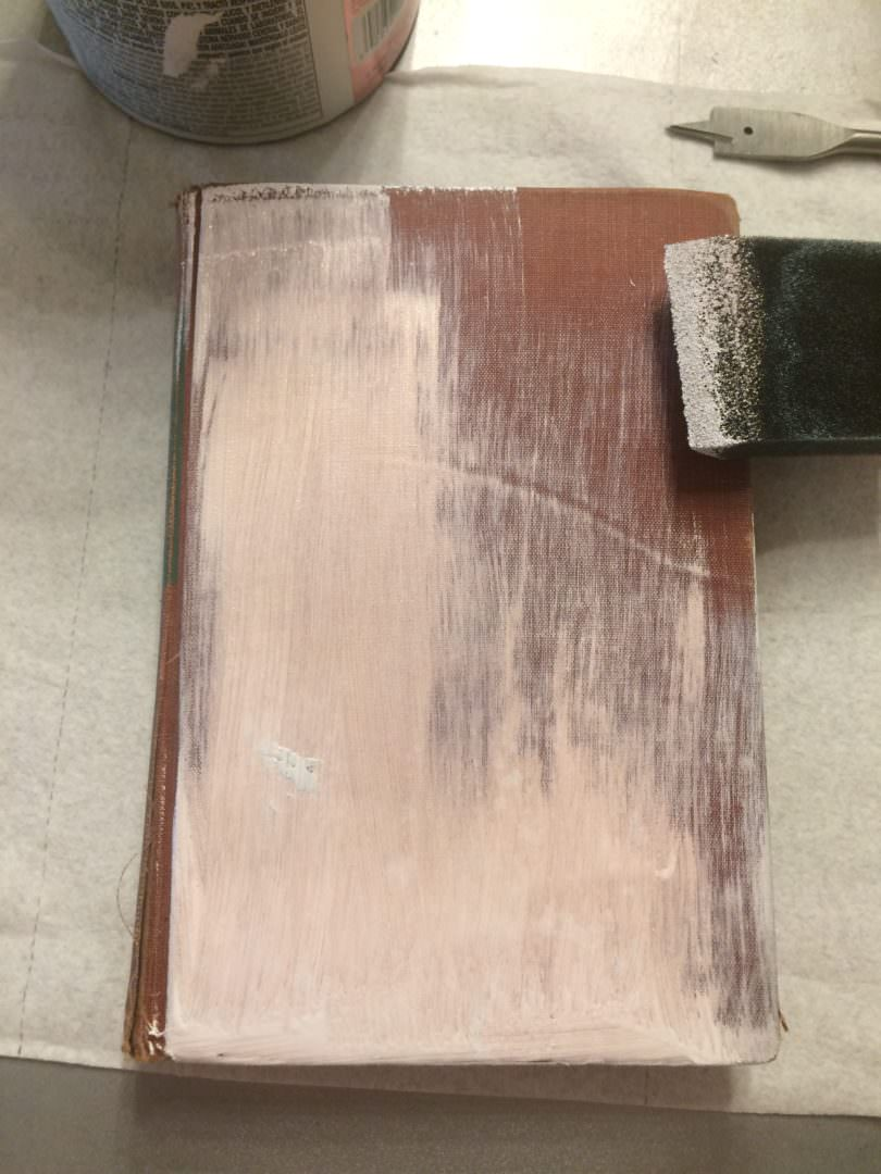 Painted book with Glidden Paint with Primer that didn't work even after 5 coats
