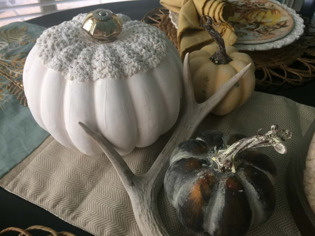 White pumpkin with doily and antler for a casual fall tablescape
