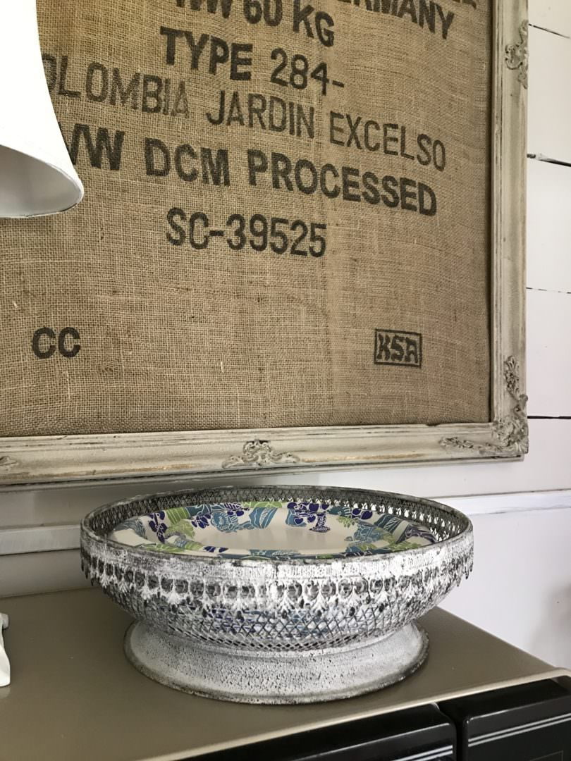 Decorating with farmhouse kitchen details like grain sacks and adding details like wire paper plate holders