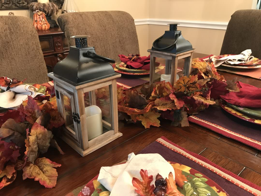 one strand of fall garland used in three different fall centerpiece ideas