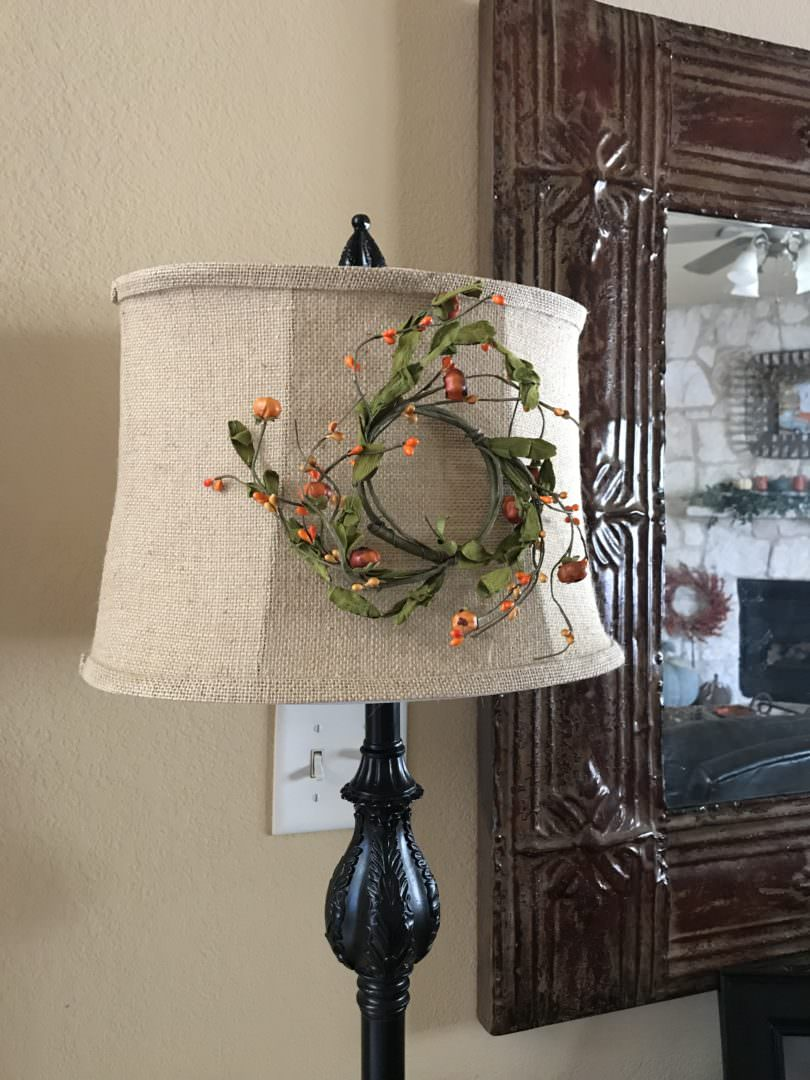 Hang a candle ring on a lamp shade for a touch of fall. Countyroad407.com
