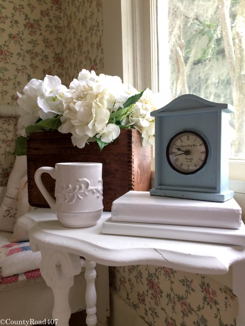 Vignette of antique box with hydrangeas by Countyroad407.com