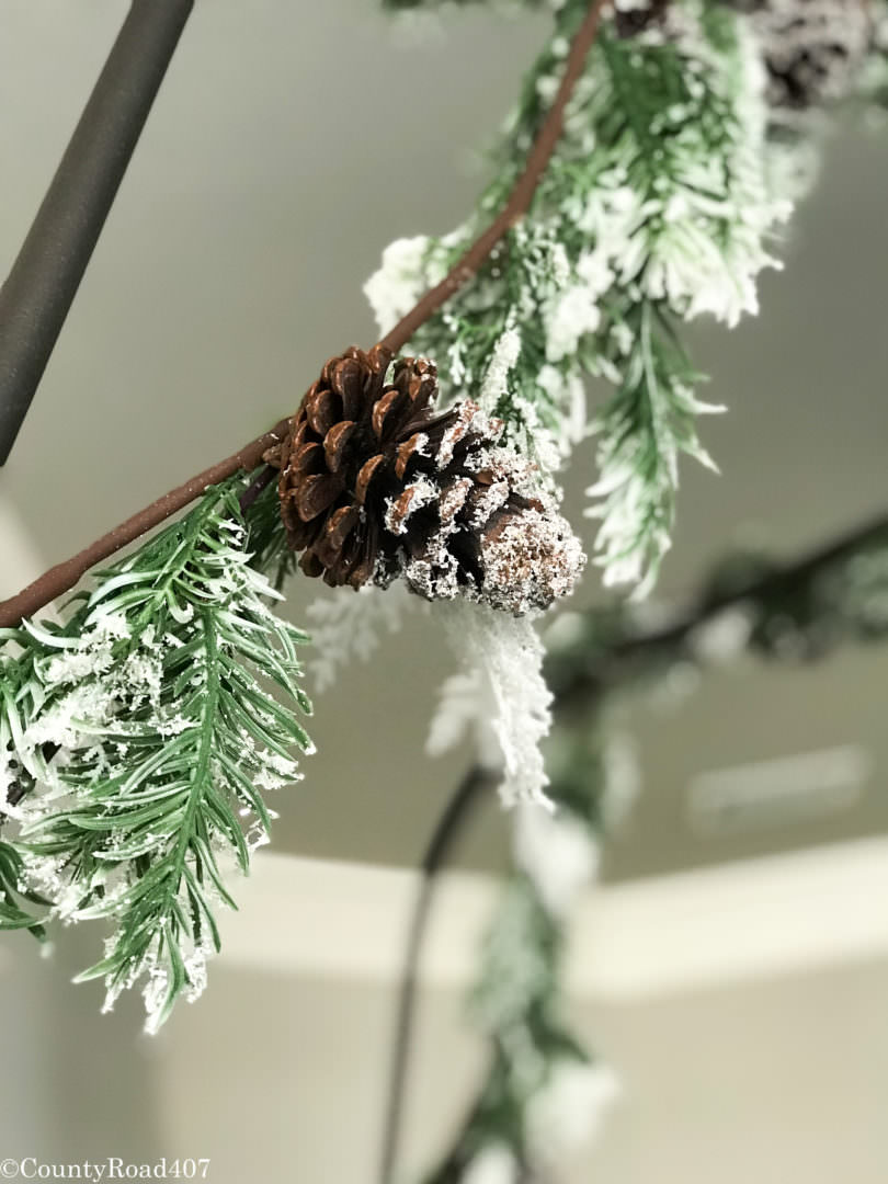 Garland from the rails of the bed make it nice and cozy for Christmas. Countyroad407.com