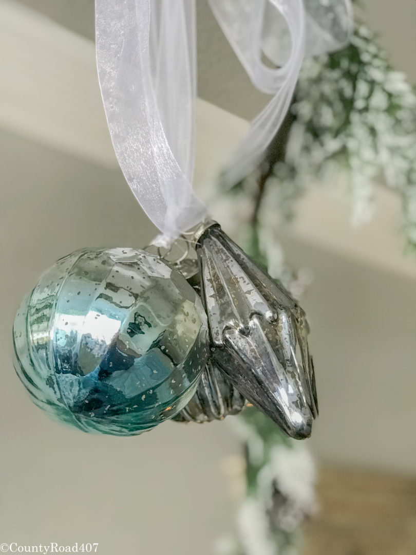 Glass ornaments are hung from the bed. Countyroad407.com