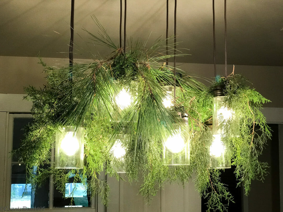 Dining light fixture with fresh greenery by CountyRoad407.com
