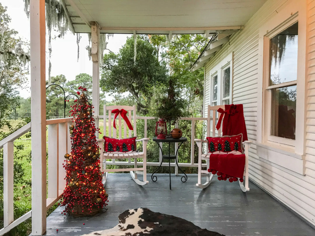Rock away on this cozy Christmas porch by Countyroad407.com