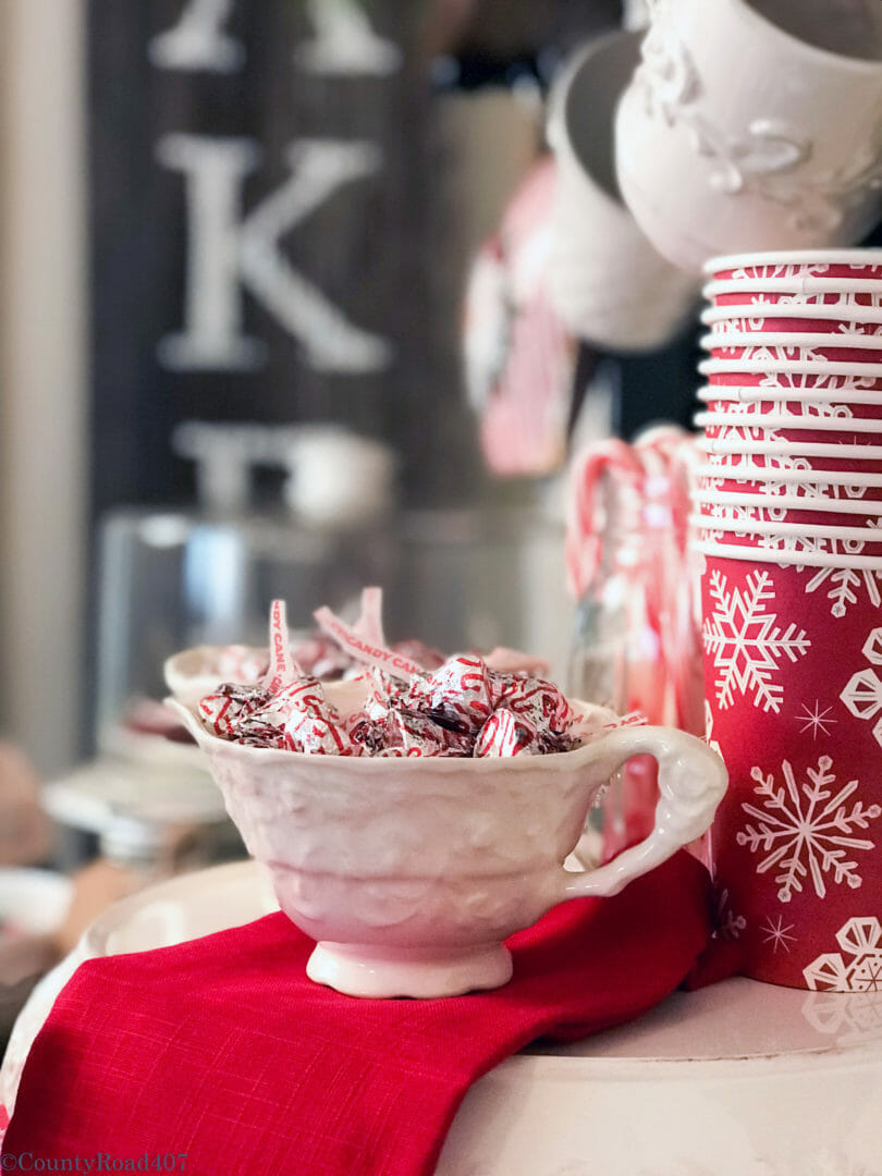 Use vintage creamer and sugar bowls for a fun look on a Christmas Cocoa Bar by CountyRoad40.com