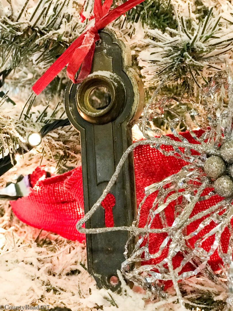 Use vintage door knob plates for unusual Christmas tree ornaments. CountyRoad407.com