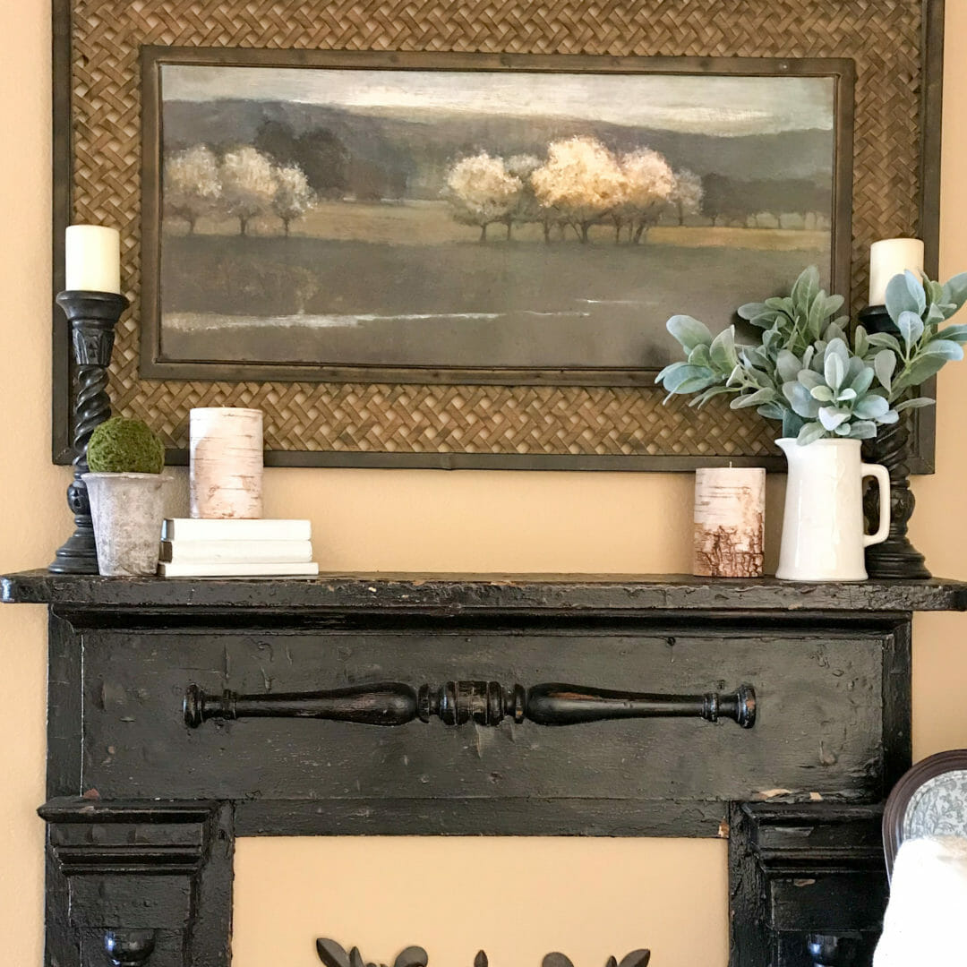 Layering is one way to decorate a mantel. Check out the east steps by CountyRoad407.com