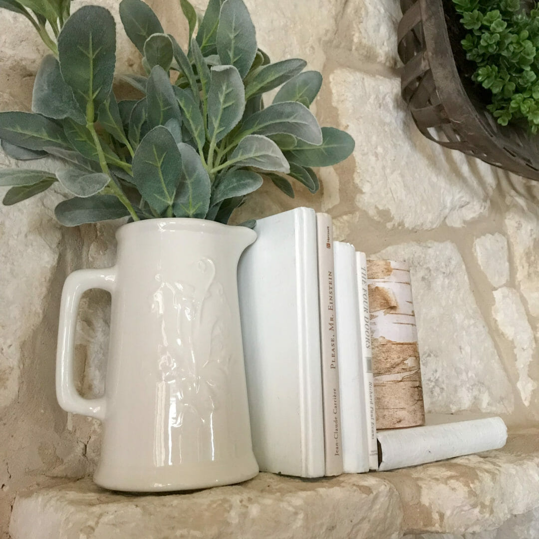 Ironstone pitcher with white books for a spring mantel on countyroad407.com