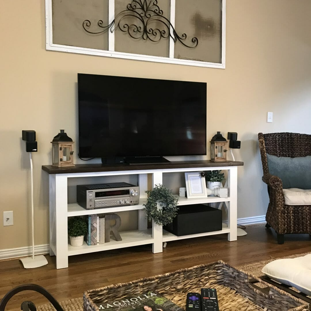 Easy tips for styling a TV console table around the ugly necessary boxes. CountyRoad407.com