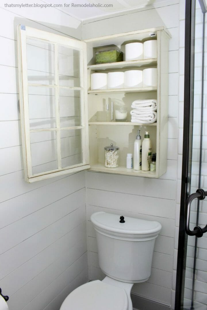 Bathroom storage made by repurposing an old window by Remodelaholic.com