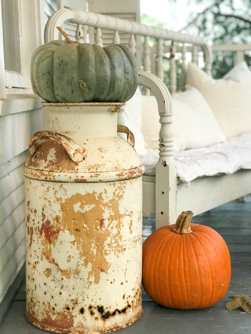 A vintage milk jug works for a farmhouse fall front porch by CountyRoad407.com
