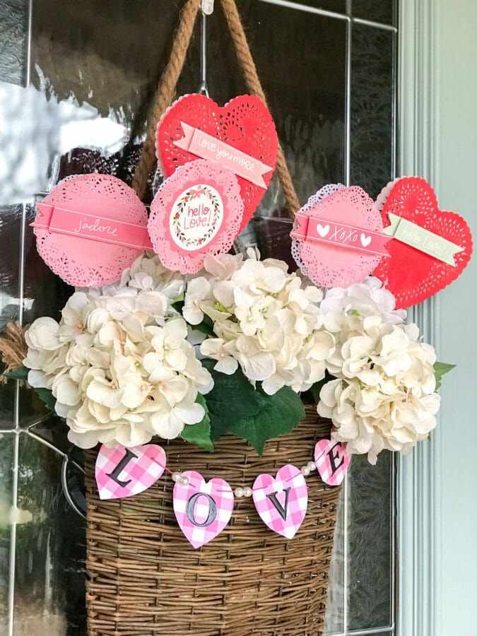 hanging basket with flowers, valentine garland and hearts