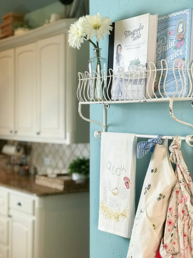 shelf with aprons and cookbooks