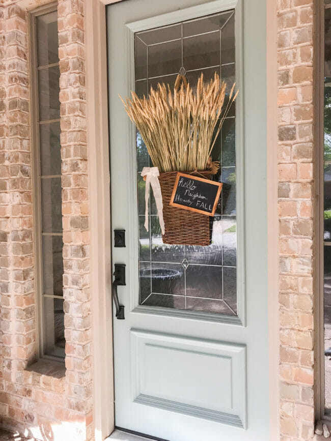 Full front door with fall hanging basket
